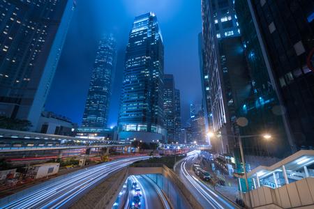 Traffic lights streak and business buildings in central district in Hong Kong. Reklamní fotografie