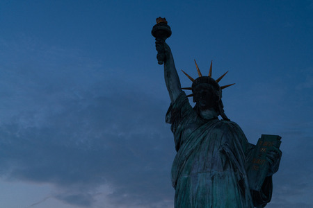Statue of Liberty at night with copyspace.