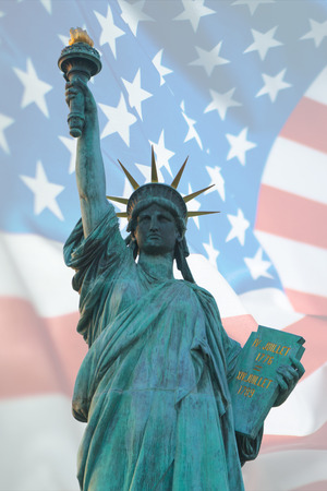 Double exposure of statue of liberty and American flag for independence day.
