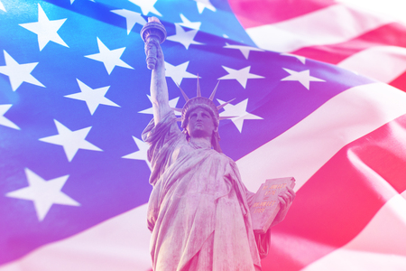 Double exposure of American flag and statue of liberty. Independence day or Memorial day concept.