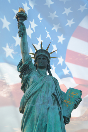 Statue of liberty with American flag double exposure