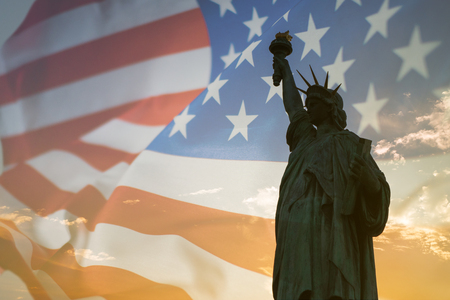 Double exposure with statue of liberty and American flag.