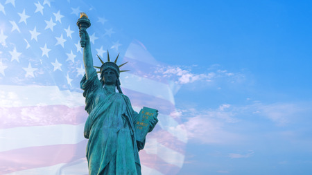 Double exposure image of American flag and statue of liberty.