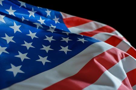 USA American flag waving on black background.