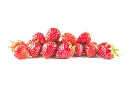 Strawberry fruit heap isolated on white background.
