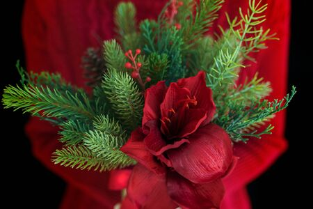 Female holding christmas flower bouquet.