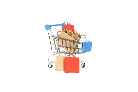Colorful shopping bags in cart isolated on white background.