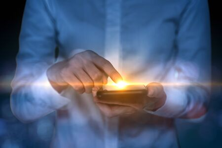 Woman use finger touch screen on smartphone with flare light.