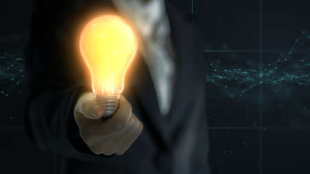 Business women holding glow light bulb for new ideas and innovative solutions concept.