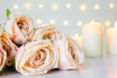 Valentine day and wedding with pink rose in pastel color, candle light in bokeh light background.