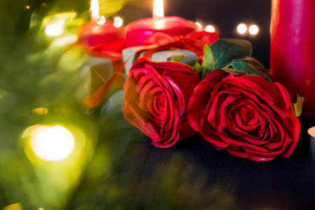 Romance flora rose and red candles.