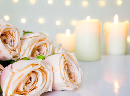 Beautiful roses and candles on white. Valentine or love concept.