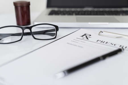 Rx prescription on pharmacy work table.