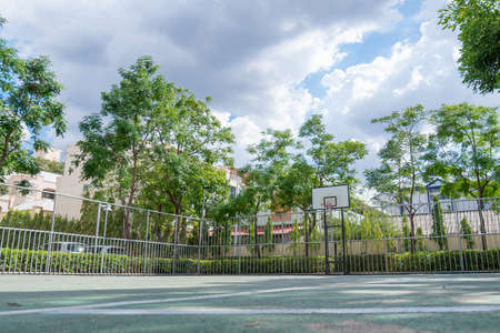 Basketball court at public park. Фото со стока