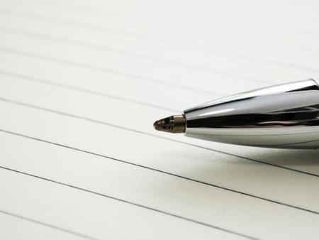 Close up of pen on notebook. Фото со стока