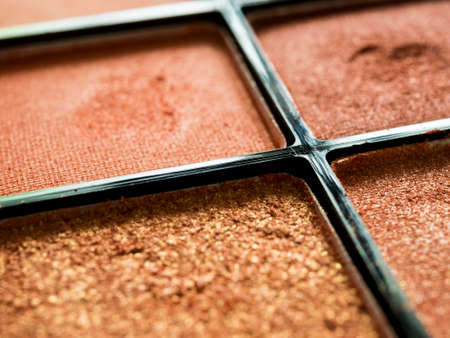 Close up of used eye shadow in package.