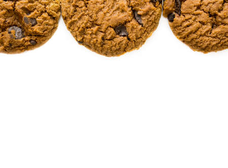 Frame of chocolate chip cookie isolated on white background with copy space.