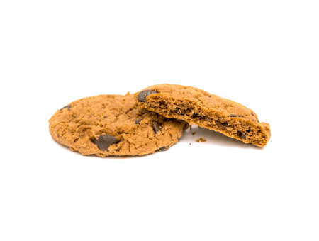 Chocolate chip cookies and crumb isolated on white background.