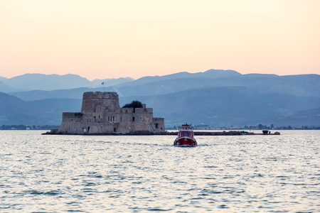 peloponissos: Bourtzi prison castle in Nafplio, Greece