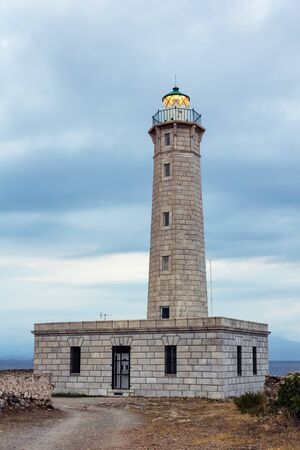 peloponnesus: Picturesque lighthouse by the sea in Greece Stock Photo