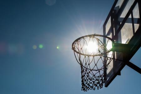 Backlit of basketball hoop