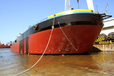 A large red and black tanker ship being renovated in a shipyard Stock Photo - 29027458
