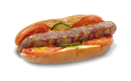 A traditional south african boerewors roll on a bread roll garnished with tomato and cucumber with tomato sauce on an isolated white background