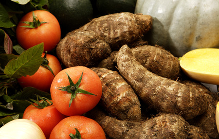 tuber vegetables: A collection of vegetables with a traditional african tuber potato called a madumbi in the center