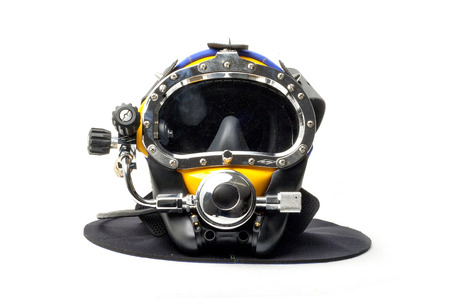 A modern day diving helmet for deep sea diving on an isolated white background