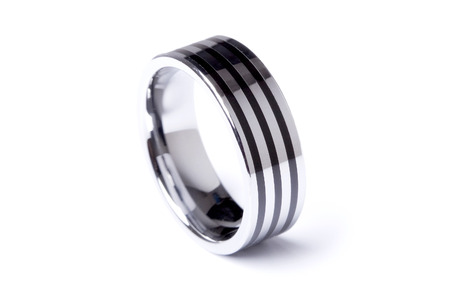 A mens plain wedding ring band made out of silver and gold on an isolated white studio background photo