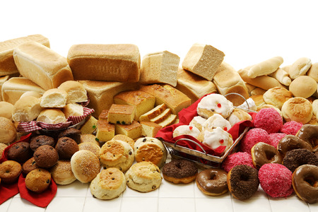 A collection of savoury and sweet baked goods on an isolated white background Stock Photo