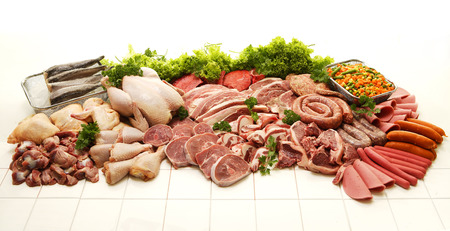 chicken meat: A display of various meats including chicken, steak, beef, fish, deli meats and boerewors on a white studio background