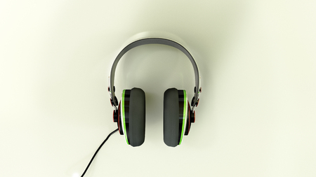 earmuff: a front view of headphones place on a shiny reflective white surface Stock Photo