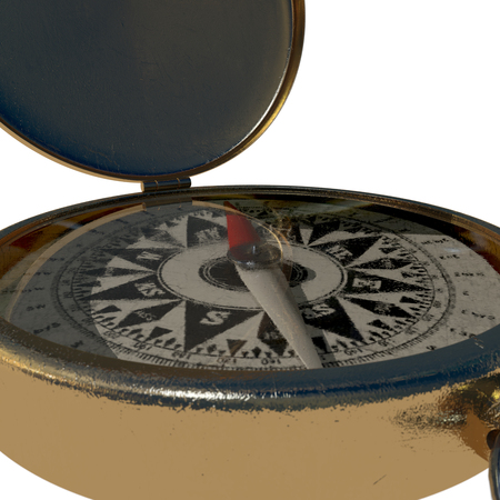 An extreme closeup of a vintage compass showing cardinal points through scratched glass
