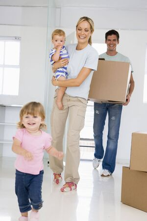 Young Family Moving Into New Home Stock Photo - 2782883