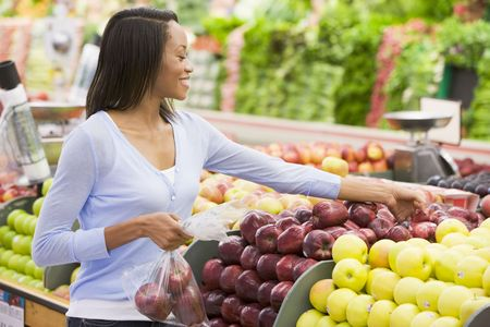 Woman shopping for apples at grocery store Stock Photo - 2802390
