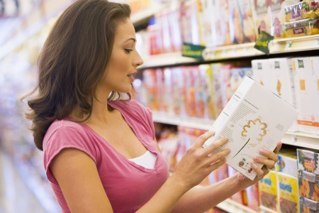 Woman shopping in grocery store photo