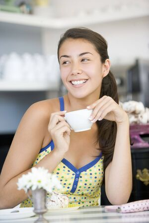 Young woman in cafe photo