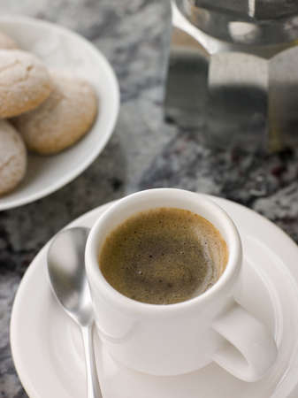 espesso: Cup of Espresso Coffee with Amaretti Biscuit