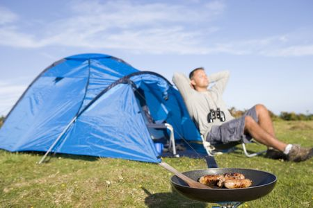 Man relaxing on camping trip photo