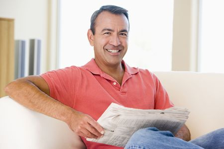 casually: Middle-aged man relaxing at home