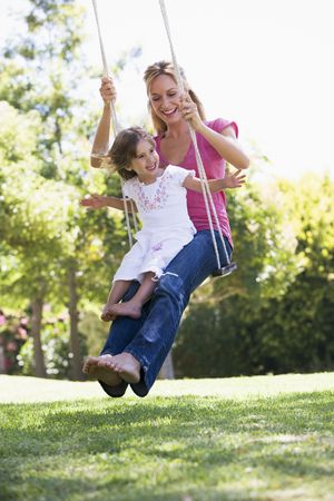 swings: Mother and daughter on garden swing