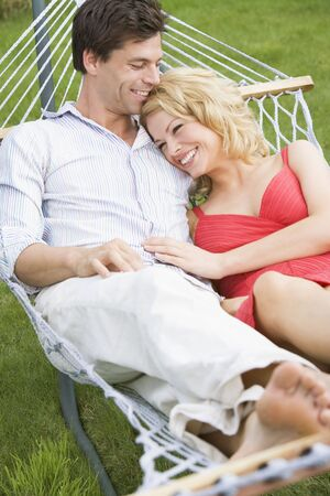 Young couple relaxing in hammock photo