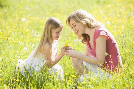 Mother and daughter in summer field photo