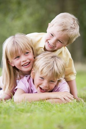 3 children playing outside photo