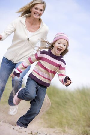 Mother chasing daughter through sand dunes Stock Photo - 2900994