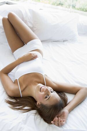Young woman relaxing in bed photo