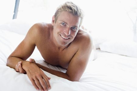 only mid adult men: Young man relaxing in bed
