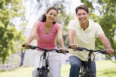 Couple riding bikes in countryside Stock Photo - 3449527