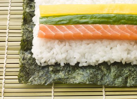 Making Rolled Sushi in a Sushi Mat Stock Photo - 2955516
